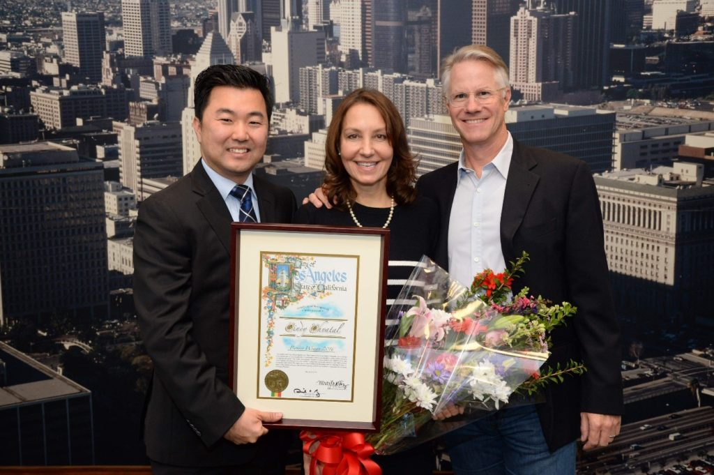 City Councilmember David Ryu (left) community leader Cindy Chvatal and Chvatal's husband John Keane celebrated Chvatal's honor of being named a Pioneer Woman by the Los Angeles City Council. The recognition goes to the woman in each council district who has made outstanding contributions to the strength, vitality and enrichment of Los Angeles.