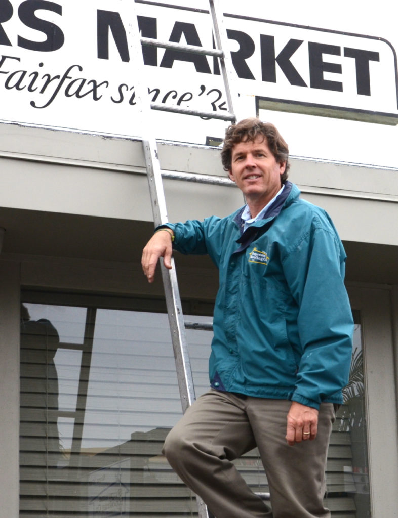 Doug Ratliff of Supreme Roofing, here at the Original Farmers Market, has roofed many of the city's most iconic structures. Photo: Kimberly Gomez