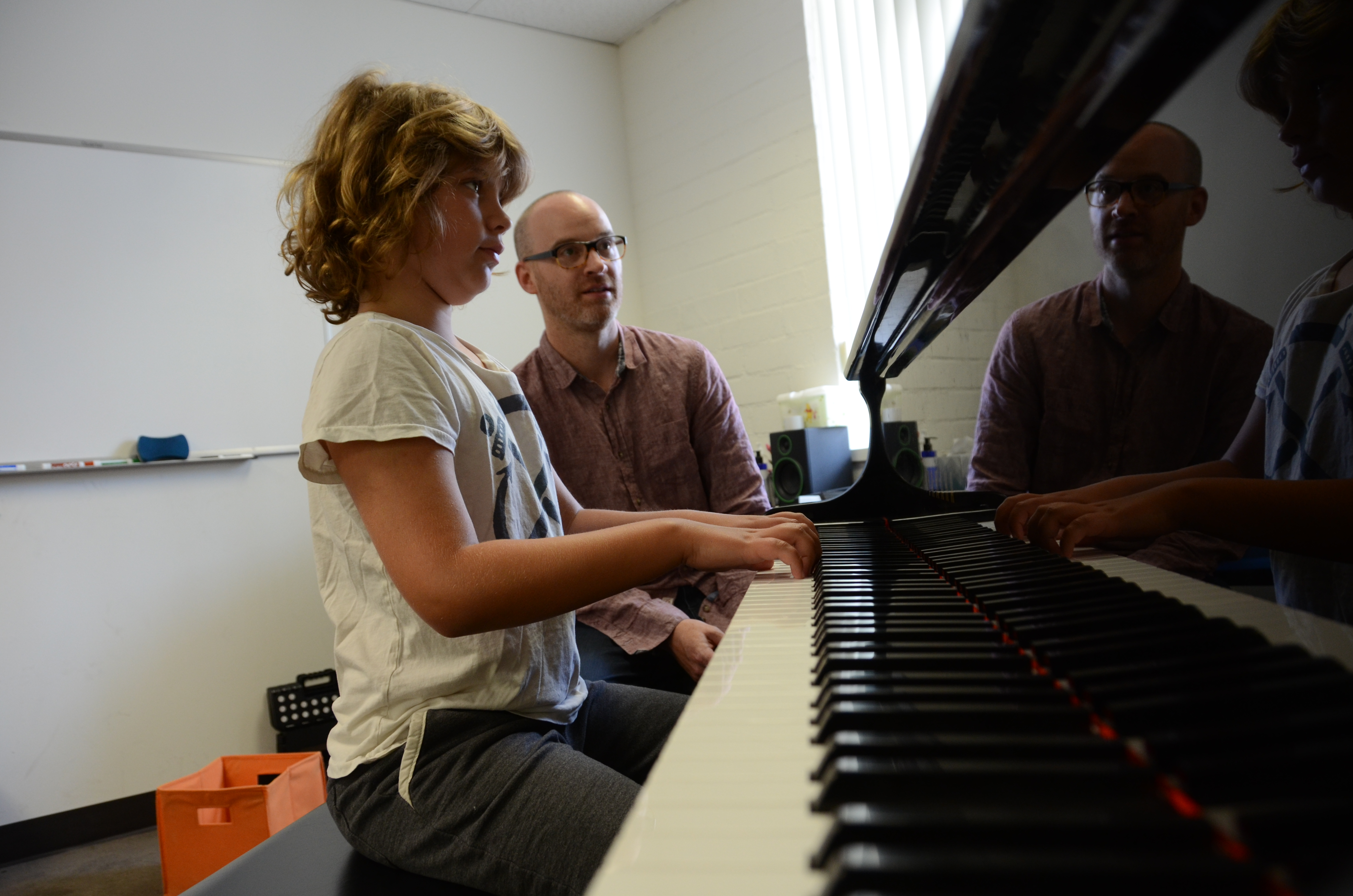 Judah Barson, 10, works through a complicated passage with encouragement from David Rhodes at Larchmont's Rhodes School of Music. Photo: Kimberly Gomez.