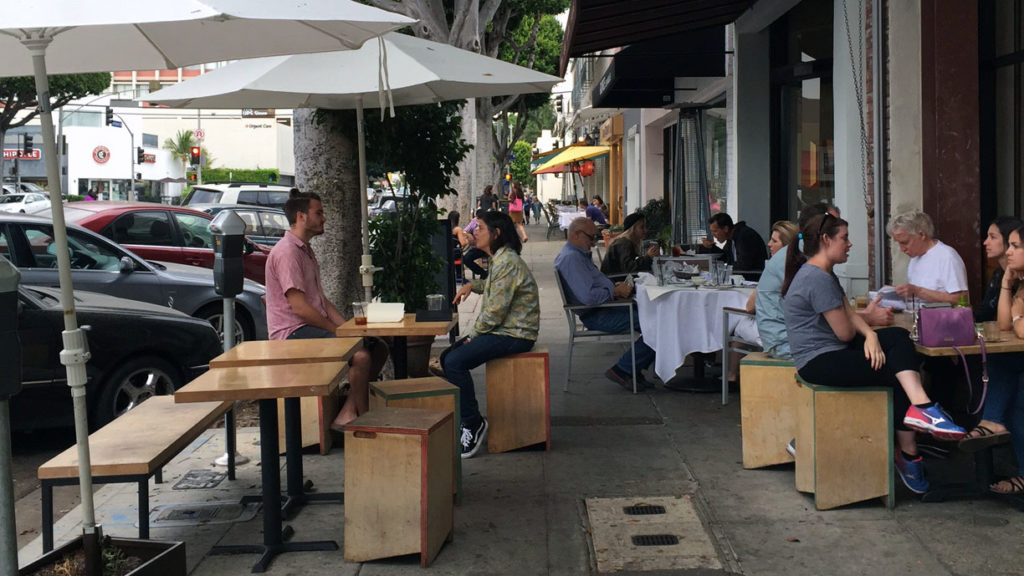 Although seemingly enjoyed by shoppers and diners alike, many of the table and chairs on Larchmont Boulevard are placed where they are not allowed to be.