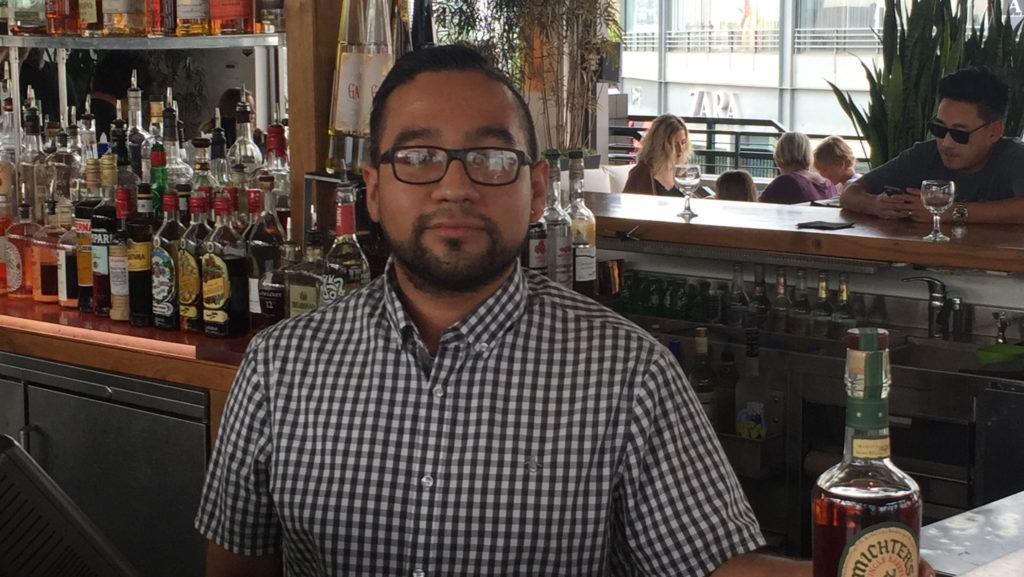 Omar Cano, bartender at Mixology 101 at the Farmer's Market.