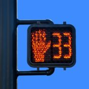The current jaywalking law was written when flashing red signals alone were instituted, and does not reflect modern crossing signals, which include a countdown.